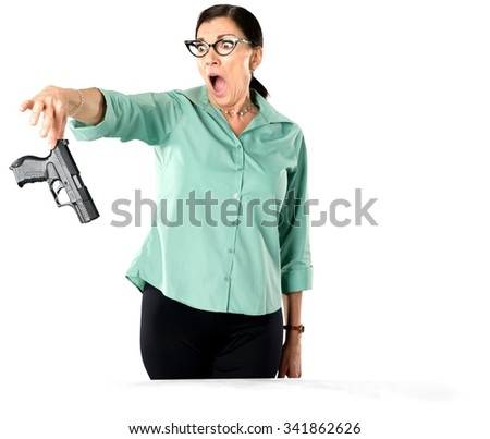 Angry Caucasian woman dark brown in business casual outfit holding handgun - Isolated - stock photo