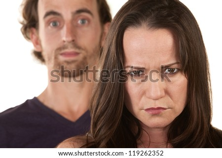 Angry Caucasian woman frowning with man behind her - stock photo