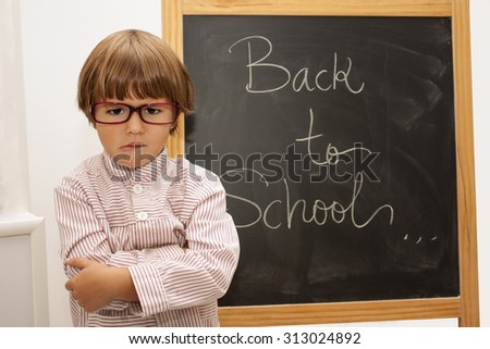 angry child not ready for the school - stock photo