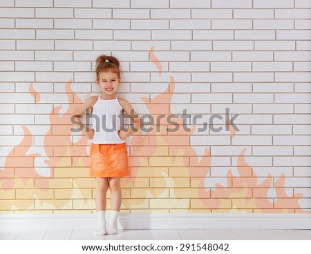angry child on the wall background - stock photo