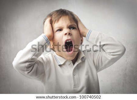 Angry child screaming - stock photo