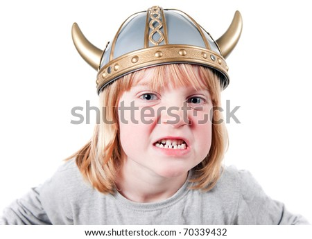 Angry child with viking helmet. boy isolated on white with expression of aggression. blond kid dressed up - stock photo