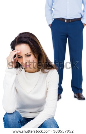 Angry couple ignoring each other against white background - stock photo