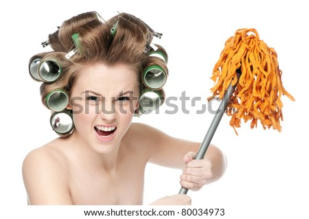 Angry crazy housewife in hair rollers is holding swab