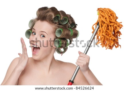 Angry crazy housewife in hair rollers is holding swab - stock photo