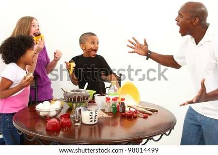 Angry dad finds kids making mess with cupcakes in the kitchen.  Interacial family over white. - stock photo