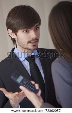 angry discussion in office between man and woman - stock photo