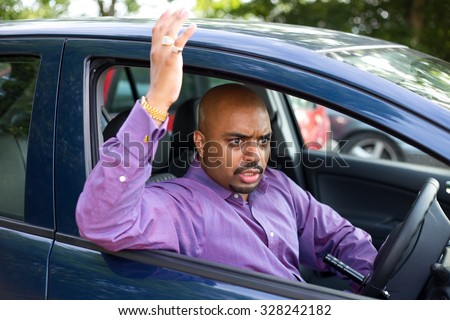 angry driver parking his car - stock photo