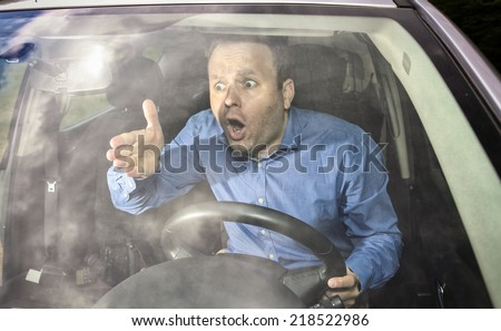 Angry driver yelling on some other driver during driving - stock photo