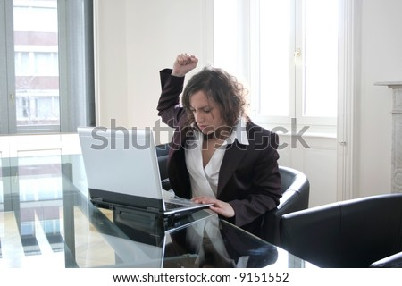 Angry executive woman attacking her computer