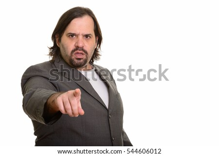 Angry fat Caucasian businessman pointing finger isolated against white background