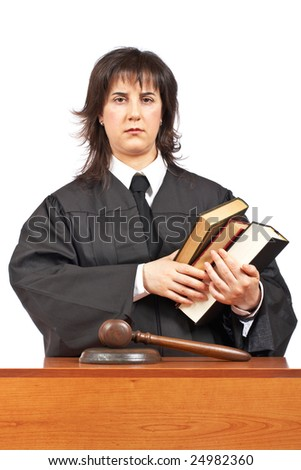 Angry female judge holding the books. Shallow depth of field - stock photo