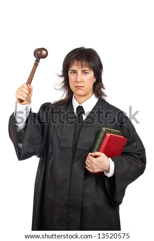 Angry female judge holding the gavel and books. Shallow depth of field - stock photo