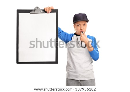 Angry female sports coach holding a clipboard with a blank paper on it and blowing a whistle isolated on white background - stock photo