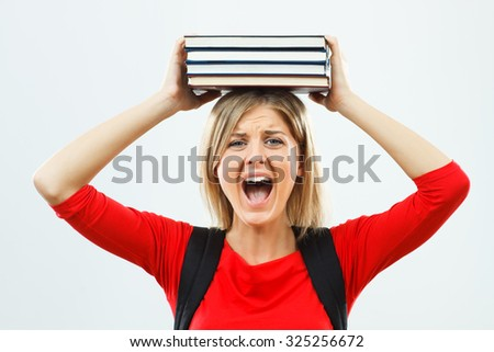 Angry female student is fed up of learning.Angry student - stock photo