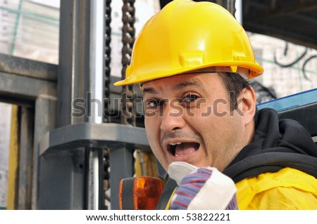 Angry forklift operator yelling - stock photo