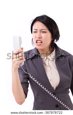 angry, frustrated business woman shouting through the phone call - stock photo