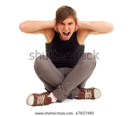 angry, furious young man with raised arms, screaming - stock photo