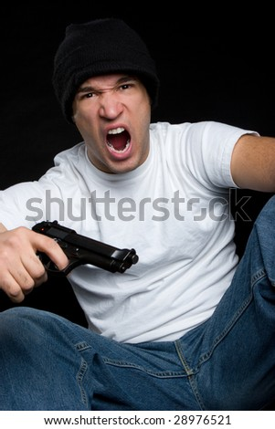 Angry Gangster with Gun - stock photo