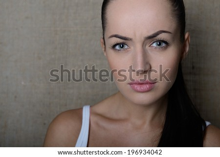 Angry girl, portrait over canvas, toned. - stock photo