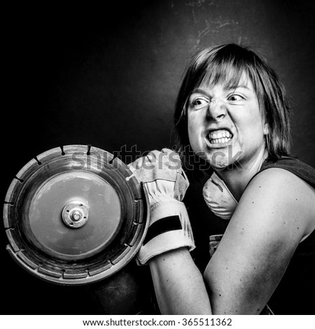 Angry girl with a heavy tool - stock photo