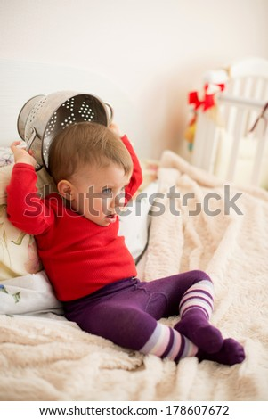 angry girl with strainer on bed