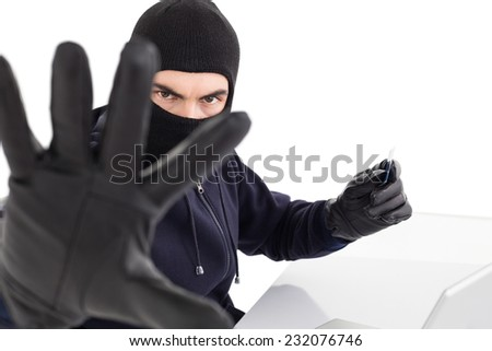Angry hacker using credit card and gesturing on white background