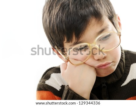 Angry little boy with glasses isolated on white - stock photo