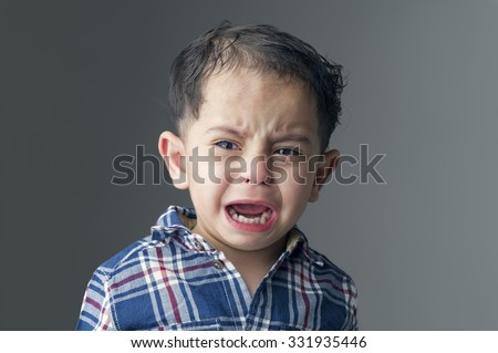 Angry little boy with sad expressions crying - stock photo