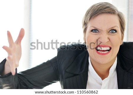 Angry mad furious businesswoman - stock photo