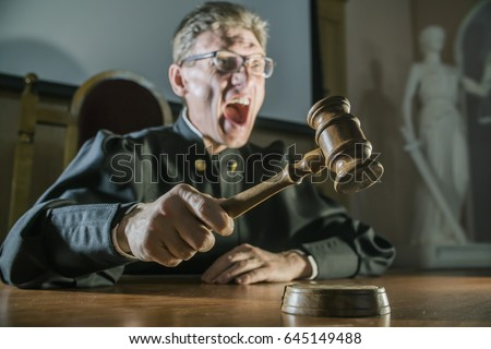 angry man a judge with a hammer in his hand in the court room cry
