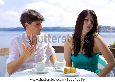 Angry man and woman having trouble in relationship