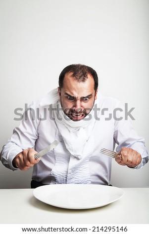 Angry man eating - stock photo