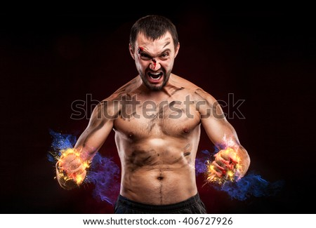 Angry man. Fire boxer standing staring strong. Young masculine caucasian male athlete.  - stock photo