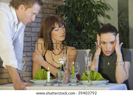 angry man looking at woman in a restaurant - stock photo