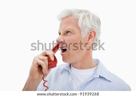 Angry man making a phone call against a white background