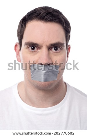 Angry man mouth covered by masking tape - stock photo