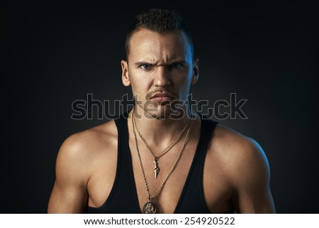 angry man on a black background