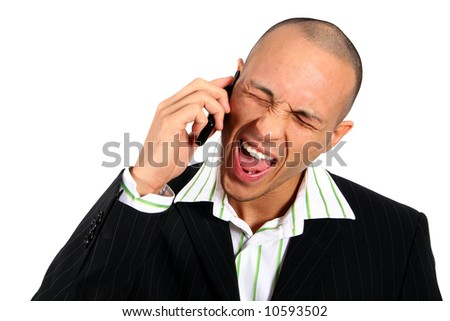 Angry Man On Phone Stylish young man in suit screaming into his cell phone. Isolated over white. - stock photo