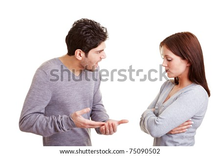 Angry man screaming insults at his girlfriend - stock photo