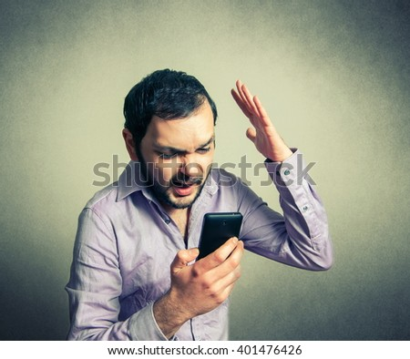 angry man shouting on the phone - stock photo