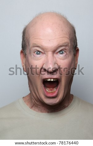 Angry man showing his teeth - stock photo