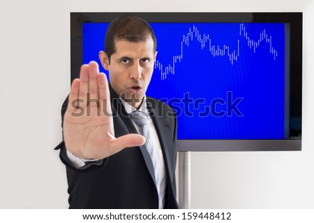 angry man signalling stop sign over graph