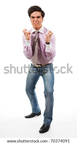 Angry man wearing jeans, shirt and tie, isolated on white