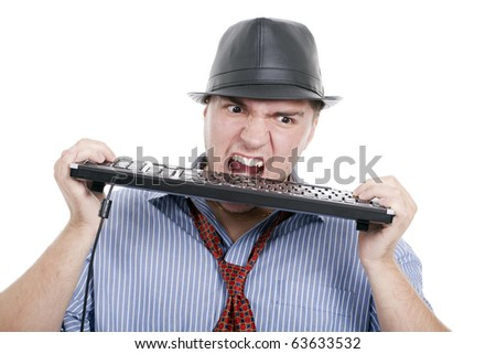 angry man with a hat and tie is destroying keyboard