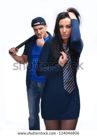 Angry man with police stick and his girlfriend on white background - stock photo