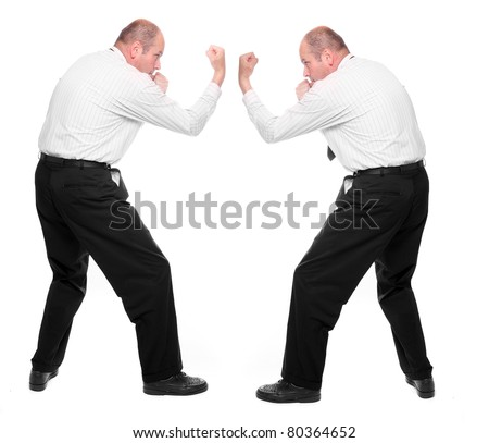 Angry manager kicking his rival. Funny picture from office. - stock photo