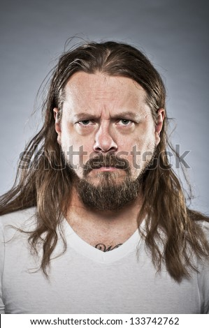 Angry Metal Dude Portrait - stock photo