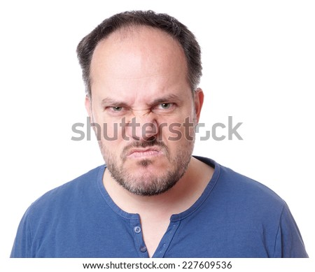 angry middle aged man with madman grimace - stock photo
