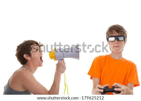 angry mother of teen playing computer games - stock photo